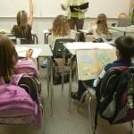 Teacher Instructing In A Classroom